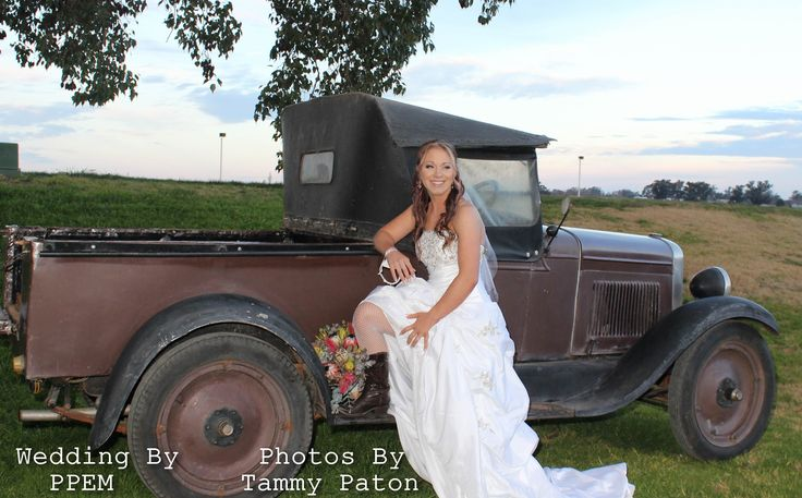 The bride wore boots. The groom wanted a vintage feel the bride wanted a country rustic so we combined the two for vintage country theme.  The ute was a 1928 Chevrolent ute. The number 28 was important number for the bride and groom, so what better way to incorporate it than to bring the number in with the much wanted vintage ute.