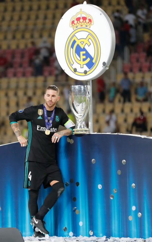 sergio ramos posed with UEFA SUPERCUP 2017 Trophy