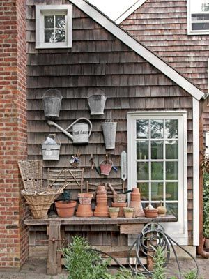 I love the watering cans on the wall.