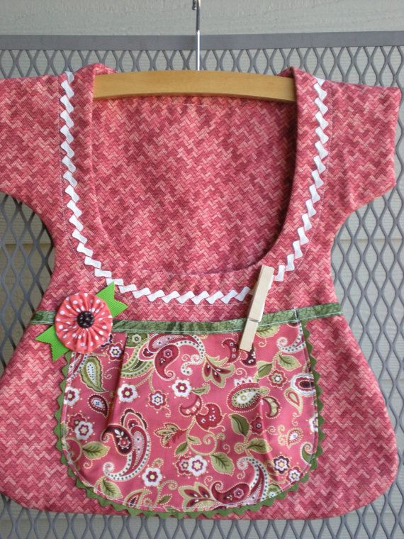 Wonderful country apron style clothespin bag is handmade from repurposed fabric and features an adorable vintage button and yo-yo. Included with