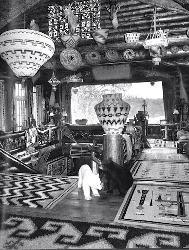 I wish this pic was in color. Great old photo featuring Indian artifacts and art.