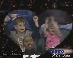 Kiss Cam . Haha, watch the guy's face in the bottom. (gif)