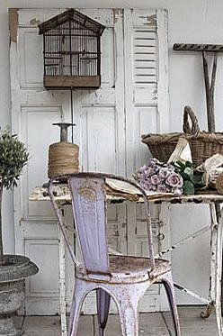 Rustic & pretty, but the rusty chair is impractical, as it would snag clothing.  To preserve the authenticity of the vintage paint, the chair could be slipcovered to make it usable--if used indoors.  This seems to be a shabby chic outdoor vignette, in which case the chair will likely continue to rust.