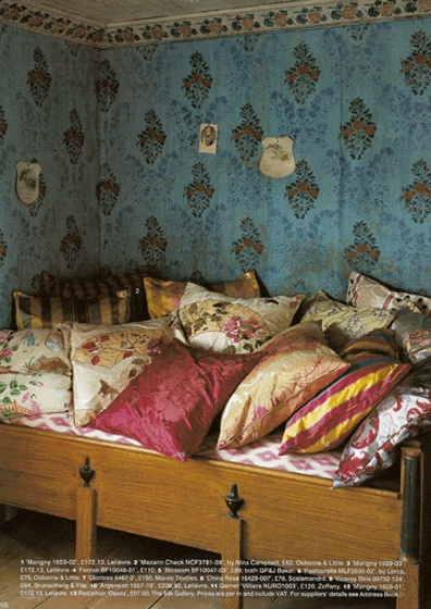 Sweet And Cozy Old Fashioned Wooden Bed In A Wallpapered Room
