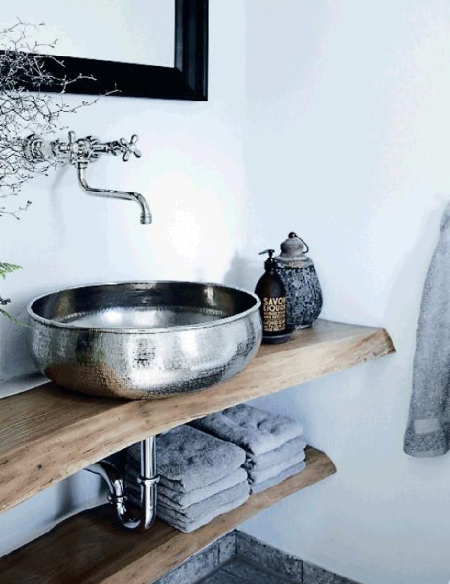 hammered metal vessel sink (12 Rustic Bathrooms You'll Adore: Bring In The Elements)
