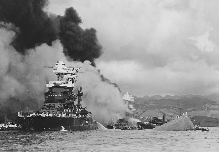 World War II: Pearl Harbor.  The USS Maryland, a battleship moored inboard of the USS Oklahoma, which capsized, was damaged slightly in the Japanese attack on Pearl Harbor on December 7, 1941.
