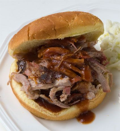 This will literally take you all day, but it is well worth the time. If you smoke it right, this will be the best tasting meat you have ever had. http://www.amazingribs.com/recipes/porknography/perfect_pulled_pork.html