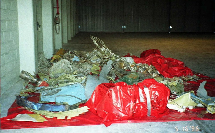 ValuJet Crash Of 1996 ~ MIAMI, UNITED STATES: Plane wreckage from Valujet flight 592 sits in a hangar at Kendall-Tamiami Airport 16 May after being recovered from the crash site.