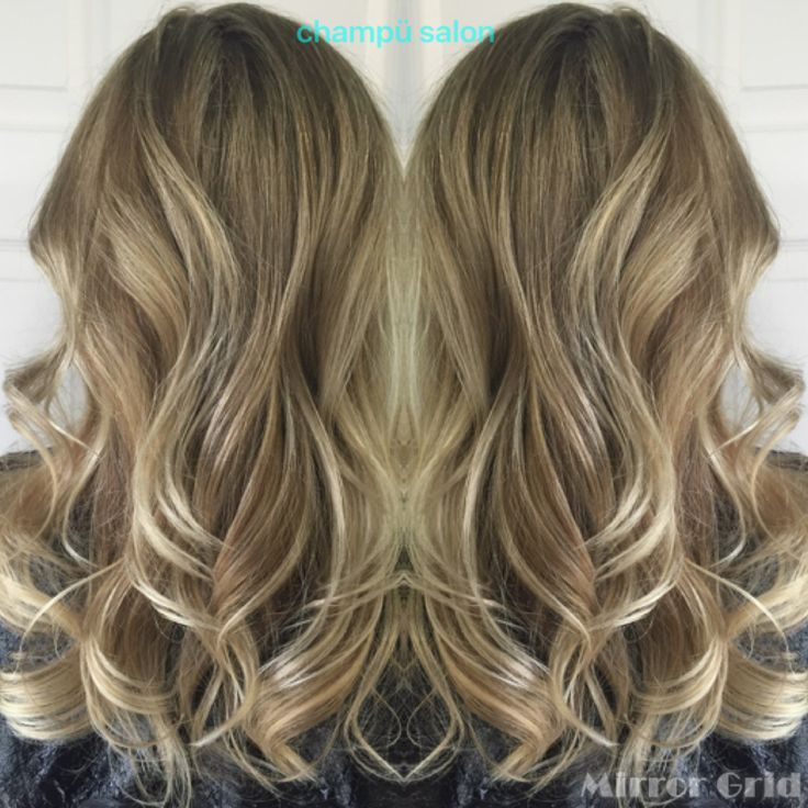 Natural looking dark blonde with highlights.