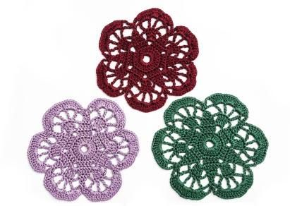 Crocheted flowers for scrapbooking.