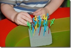 Tiny Swords and a Foam Block Fine Motor Play
