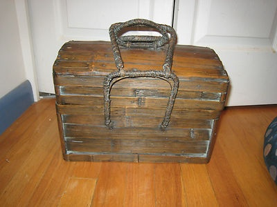 This is a fine example of work done by craftsmen from days gone by. The picnic basket is in the shape of a treasure chest.  It measures 13x9x9.  There are no markings as to the manufacturer. .