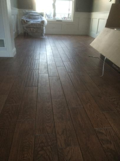 One trick to avoid making your floors look less like tile is to stagger the tile size and placement (see my picture.)