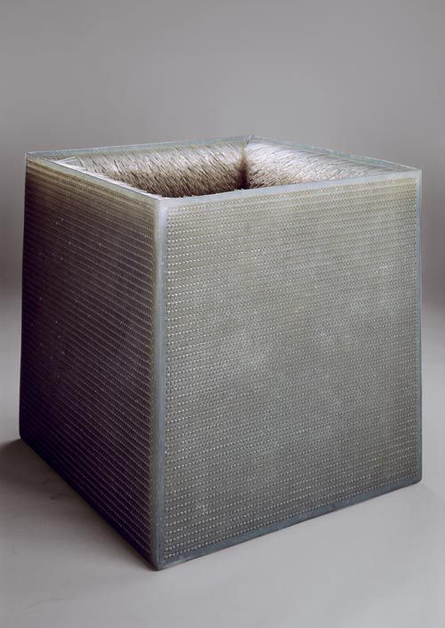 Eva Hesse, Accession III, 1967 Post-Minimal Cubes • Cube with holes drilled into it and rubber piping woven into it.