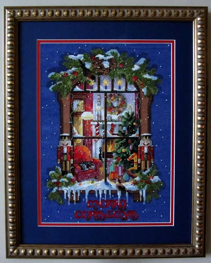 A Christmas cross stitch which kept me occupied while I was recovering from several knee operations and not able to walk much.
