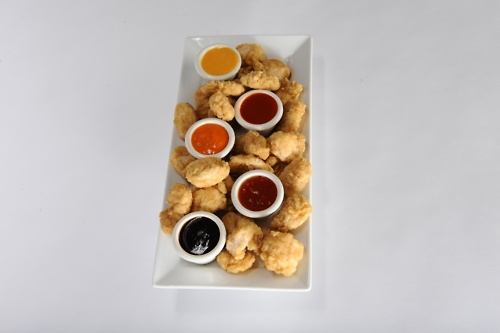Garlic Jim's Boneless Chicken Bites.  Delicious.  7 Dipping sauces to choose from makes them even better.