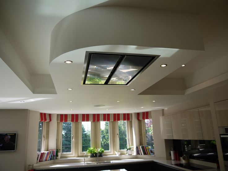 Gloss cashmere kitchen.  Ceiling detail, mirrored from shape of the island with flush fitting ceiling extractor.