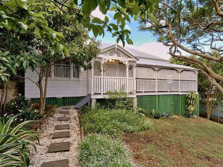 "Always raised off the ground for ventilation and often to keep dry in times of flood these homes with their core of four main rooms, a central hallway and surrounded by verandas on most sides filled the landscape of my childhood. ""Queenslanders"" we call them ."