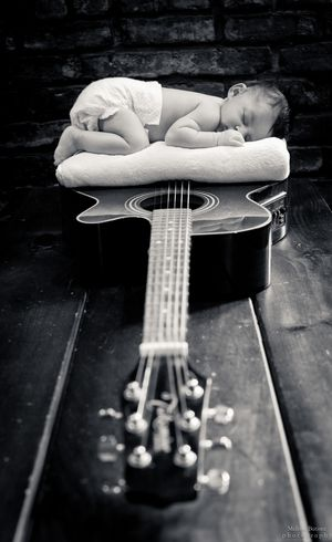 Infant photo session. Baby on guitar