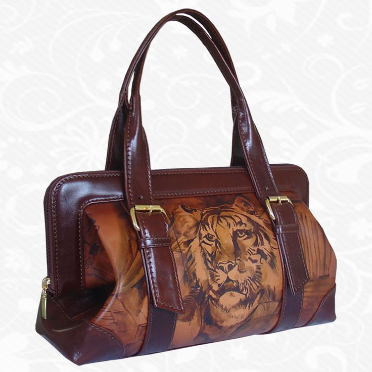 Feature: Lion   Original hand-painted leather handbag. There is only one piece. Each piece is hand-painted work of art products. Handbag is a beautiful unique original painting. http://www.vegalm.sk/