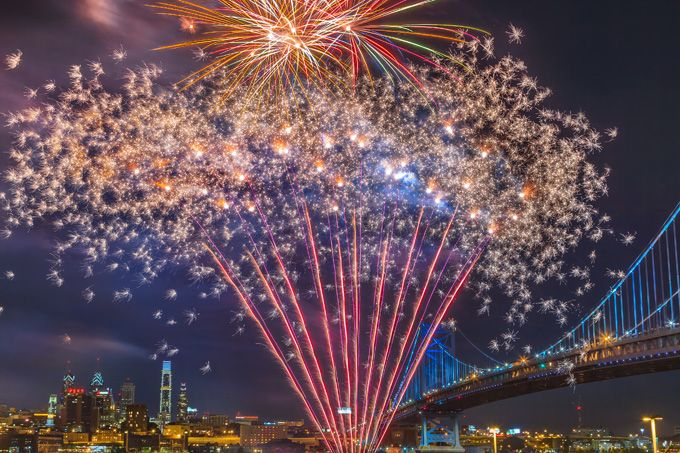 On Saturday, June 27, fireworks burst over the Delaware River. Remember, on the 4th of July, the fireworks are over the Parkway only. (Photo by G. Widman for Visit Philadelphia)
