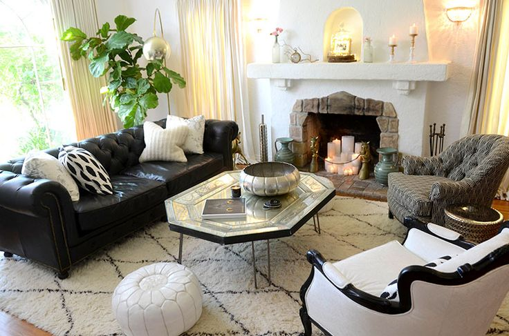 gorgeous black and white living room, with mixed metals and reupholstered vintage furniture.