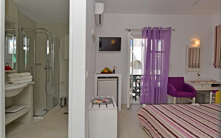 Double - Triple Room of Kalypso Hotel in #Naoussa_traditional_Village_in_Paros.