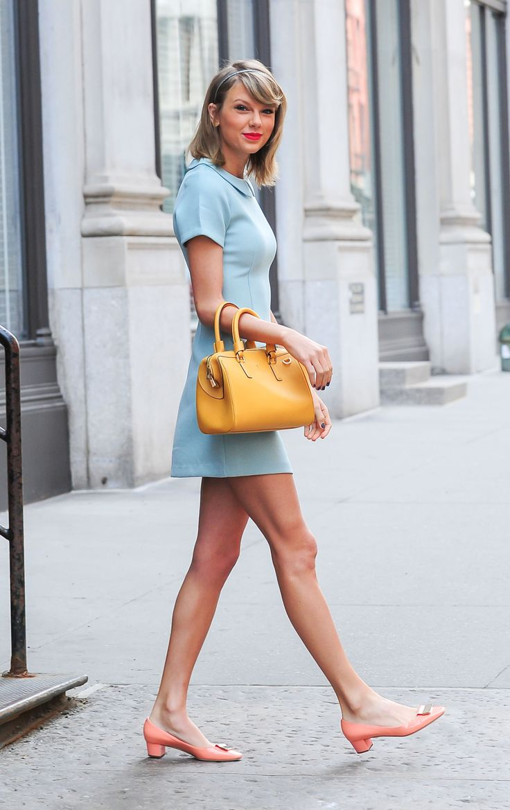Taylor amped up her pastel blue dress with a matching headband, mustard purse, and adorable peach flats. - Seventeen.com