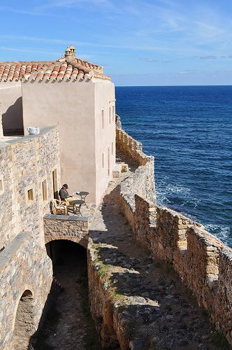 """The rock of Monemvasia  (Laconia, Peloponnese, Greece)    The town's name derives from two Greek words, mone and emvasia, meaning """"single entrance"""". Its Italian form is Malvasia.    Ατενίζοντας το πέλαγος photo by maska_29 from Flickr at Lurvely"""