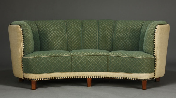 Banana-shaped Art Deco sofa upholstered in green and bright upholstery. 1940.