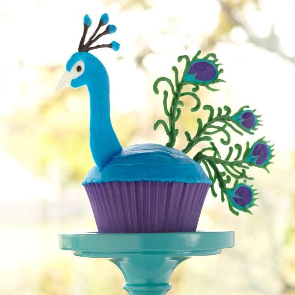 Transform a simple cupcake into a beautiful peacock with Candy Melts candy. A symbol of immortality and beauty, the peacock cupcake will be a hit at your next get-together.