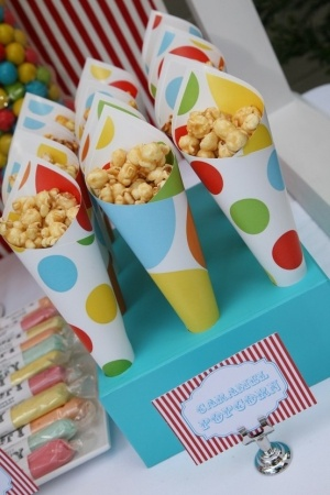 Original pin had scrapbook paper cones filled with carmel corn. I like the Ferris wheel cake!!