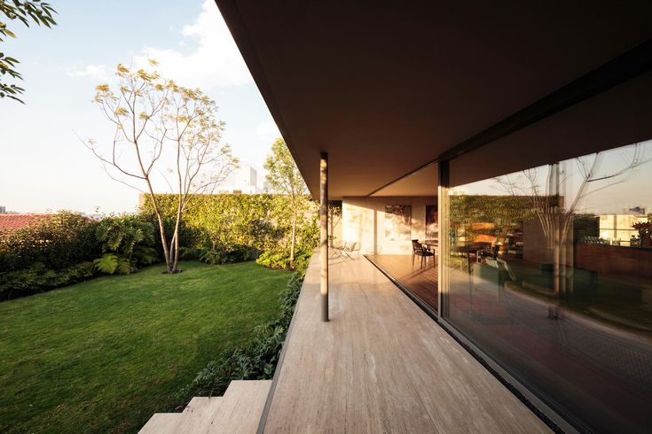 """Caúcaso House rises above the sidewalk and over the surrounding trees Architects:JJRR/ARQUITECTURA Location:Ciudad de México, México Year: 2016 Area: 8.073 ft²/ 750 m² Photo courtesy:Nasser Malek Description: """"Located in a residential area of Mexico City, Caúcaso House rises one meter and thirty centimeters above the sidewalk in order to take advantage of the view, because …"""