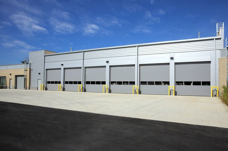Montgomery County Public Safety Training Academy, located in Gaithersburg, MD. This commercial building includes (6) gray colored Overhead Door 596 Thermacore® Commercial Sectional Series garage doors.