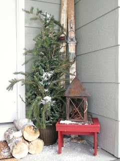 Christmas Porch......like the simple pile of logs, and the Charlie Brown Christmas tree :)