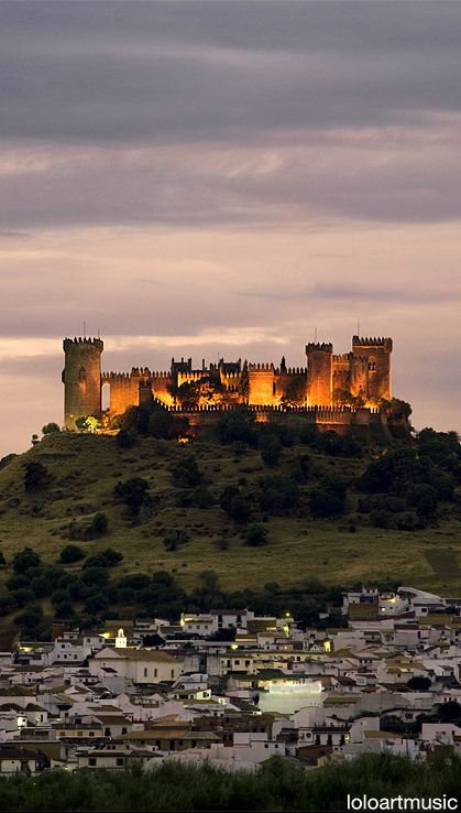 CASTLES OF SPAIN - Castle of Almodóvar del Río is a castle of Muslim origin, it is situated 15 miles (24 km) from Córdoba, on the left bank of the river Guadalquivir. Previously a Roman fort, the current structure has Berber origins, year 760. During the Middle Ages it underwent several renovations and reconstructions. Between 1901 and 1936, it was restored by the owner Raphael Desmaissiers, 12th Count of Torravala.