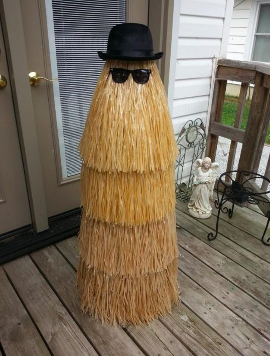 Here's a fun one — use a tomato cage and grass skirt to put Cousin Itt from <i>The Addams Family</i> on your porch.