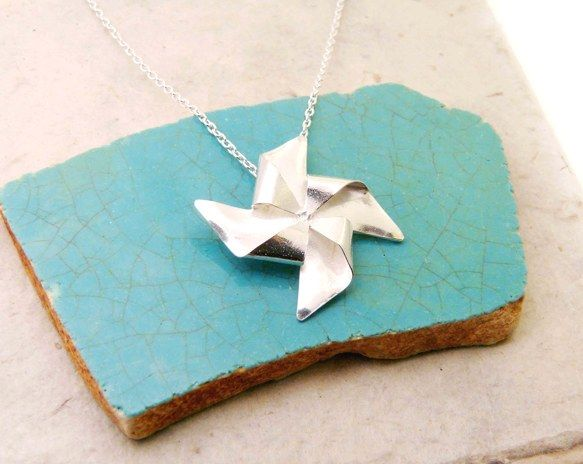 Silver Pinwheel Necklace:Pinwheels for Prevention. April is National Child Abuse Awareness Month.