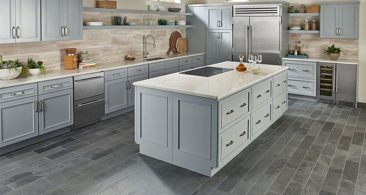 Want more wow in your kitchen? Introduce an unusual pairing like White Oak Marble on the backsplash with Montauk Black Slate planks on the floor. This creative tile combo will take your kitchen from bland to bold!