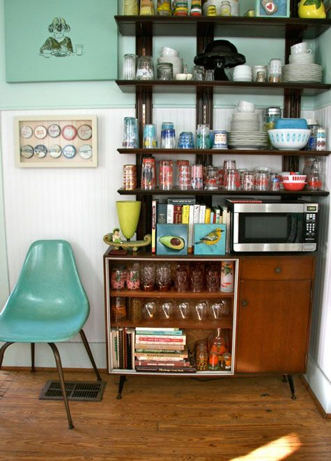 I love everything about this kitchen! Awesome collection of vintage glassware, blue/green hues... exposed shelving. I'll say it again - EXPOSED SHELVING. In a kitchen. That's right... do away with those bulky cabinets. Show off that dishware! Via The Design Sponge.