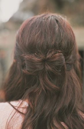 Create a unique hairstyle with this half-up bow hairstyle.