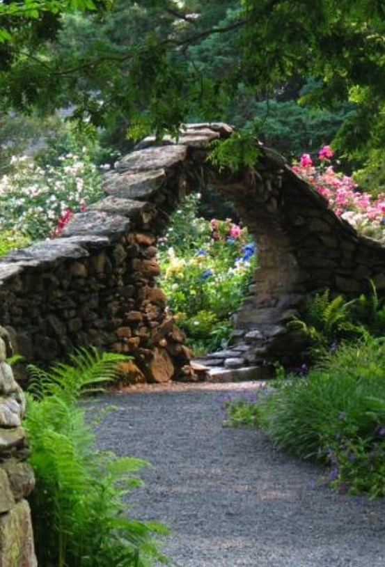 In garden in England my grandfather built a moon gate like this one...as a child I loved going through it!