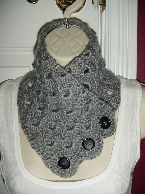This is a Neck Warmer Scarf. One size fits most average Adults.    It is made of a soft Acrylic yarn.    This neck warmer is 27 Long X 5 3/4
