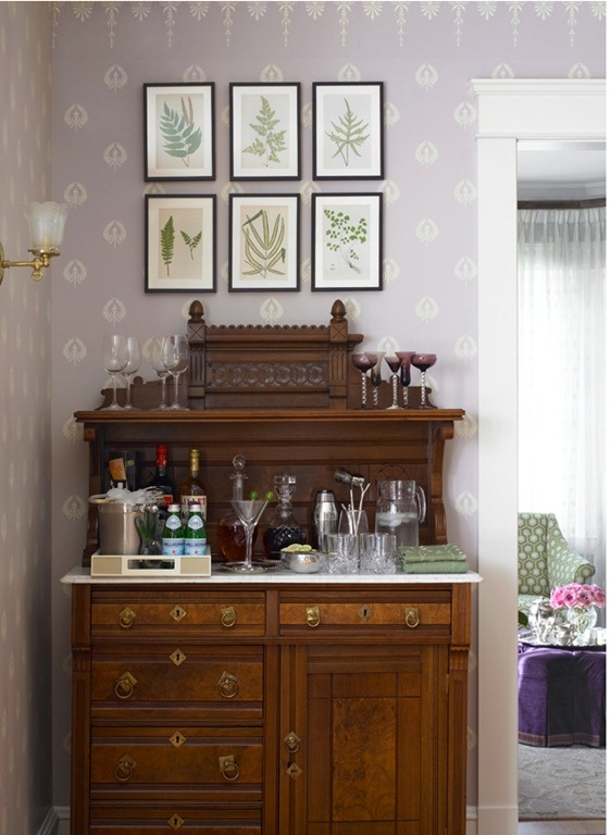 love the bar set up and the antique framed ferns