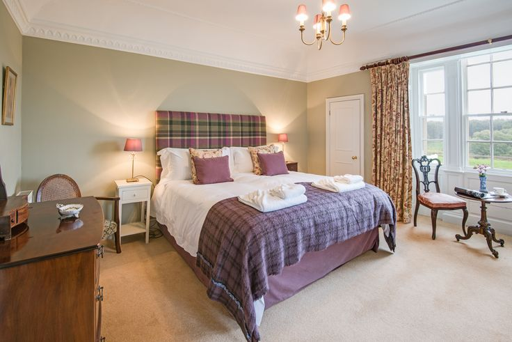 Imagine waking up in this sumptous superking bed overlooking the River Tweed in Coldstream. We love the tartan headboard and throw - a real Scottish twist to the decor!