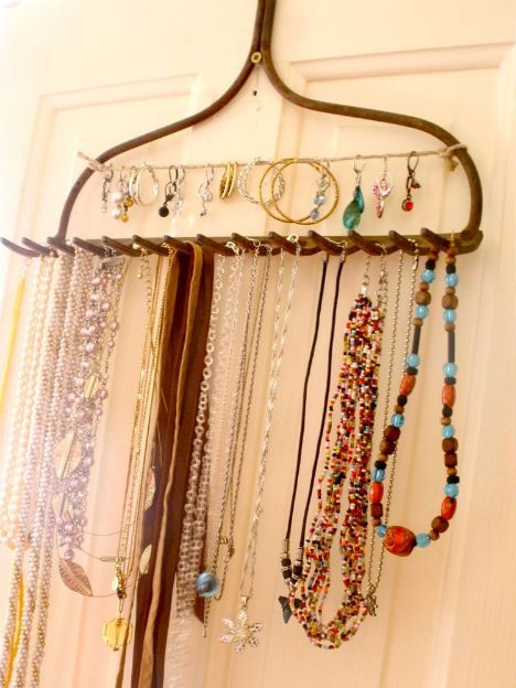 Recycle a garden rake for a great shabby chic jewelry display.