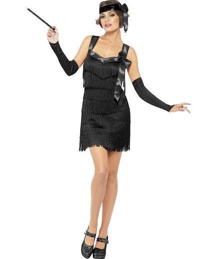 20-luvun Flapper-asu; musta. 20-luvun Flapper-tyylinen naisten naamiaisasukokonaisuus rajoja rikkovalle kaunottarelle.