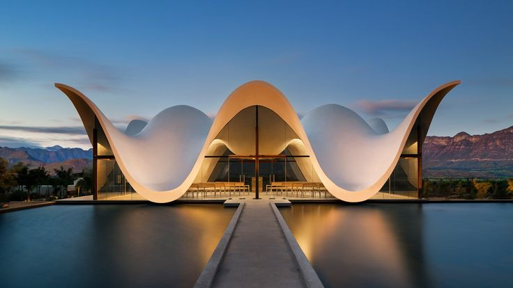 Bosjes Chapel in South Africa features a sculptural, undulating roof - Curbedclockmenumore-arrow : The striking chapel has glazed walls that frame mountain and orchard views
