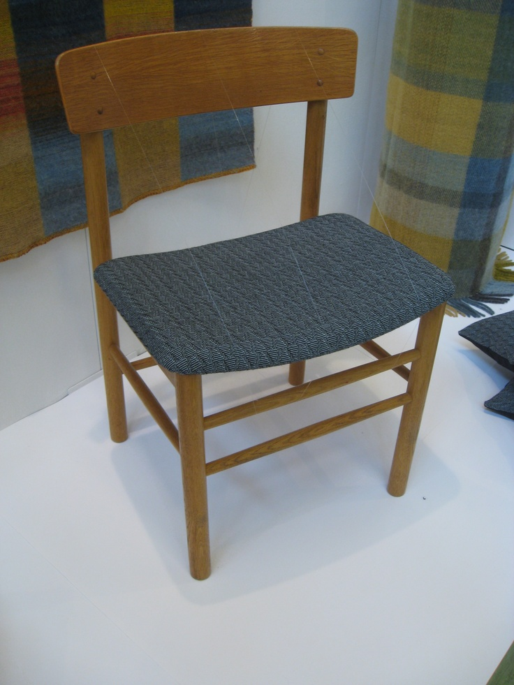 Upholstered chair with handwoven fabric.