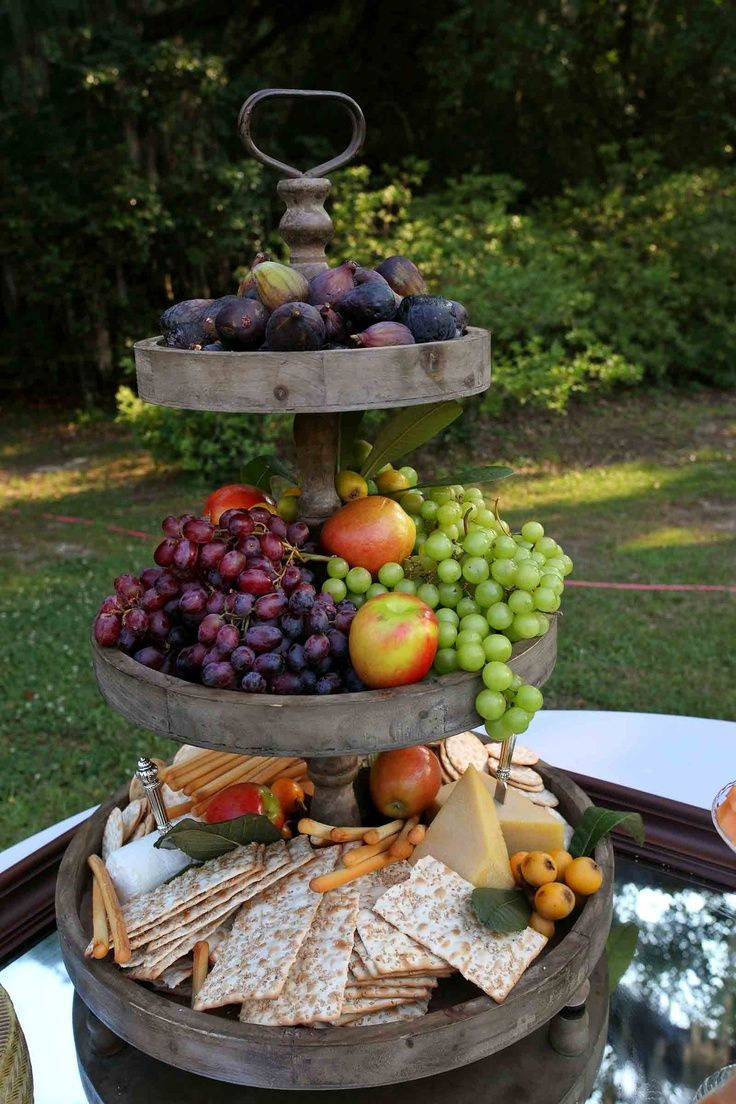 Tiered fruit & cheese presentation is beautiful way to display.